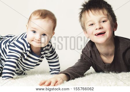 Kids. Little Sister and Brother. Baby Girl and Boy Sibling (8 months and 7 years old)