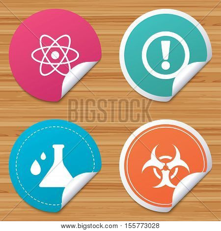 Round stickers or website banners. Attention and biohazard icons. Chemistry flask sign. Atom symbol. Circle badges with bended corner. Vector