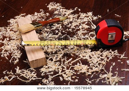 Shavings of wood, brick and roulette for measuring