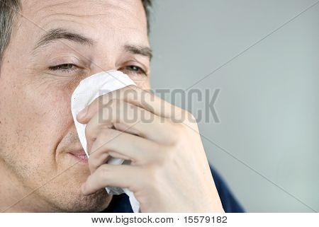 Man Holding Tissue On Nose