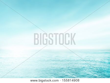 Soft focus surfing wave on summer ocean background. Blue water and sky bright. Nature blur of sea daytime with sunlight. Abstract blurred view outdoor window backdrop.