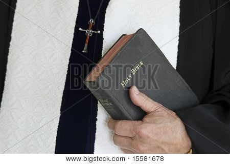Minister With Bible in One Hand