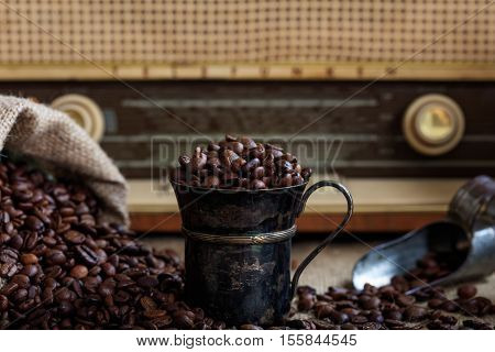 Coffee Beans Infront Of An Old Radio