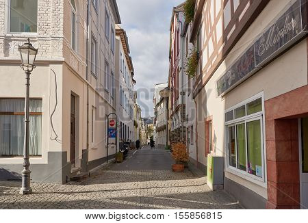 BOPPARD, GERMANY - NOVEMBER 06, 2016: Two unidentified nuns walk along a light flooded narrow alley