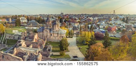 Panorama of the ruins of old castle in Targoviste, Romania. Old Royal Court ruins and the Royal Church of Targoviste, former Wallachian capital during the reign of Vlad Dracula, who also lived there.
