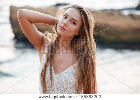 Beauty model on the beach. looking away. so pretty