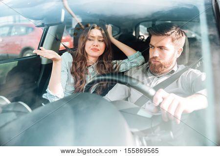 Dispute couple in car. fashion couple