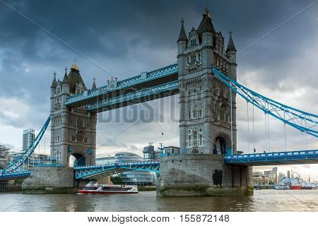 LONDON, ENGLAND - JUNE 15 2016: Night view of Tower Bridge in London in the late afternoon, England, United Kingdom