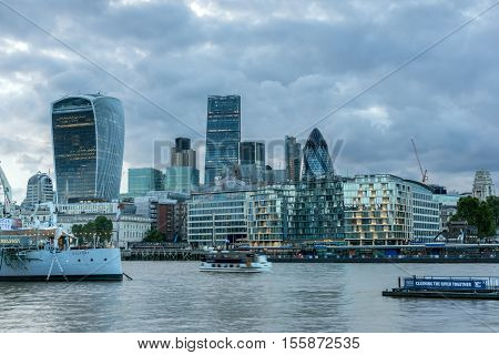 LONDON, ENGLAND - JUNE 15 2016: Amazing Sunset Skyline of London From Tower Bridge, England, United Kingdom
