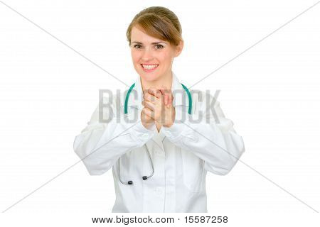 Smiling medical doctor woman showing partnership gesture isolated on white