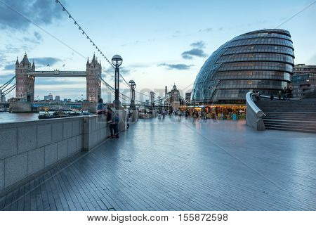 LONDON, ENGLAND - JUNE 15 2016: Tower Bridge and City Hall in London in the late afternoon, England, United Kingdom