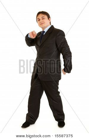 Happy medical doctor woman holding gift behind her back and thumbs up isolated on white