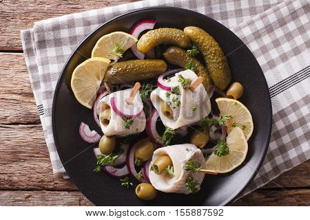 Tasty Rollmops Stuffed Olives, Onions, Pickles And Lemon Close-up On A Plate. Horizontal Top View