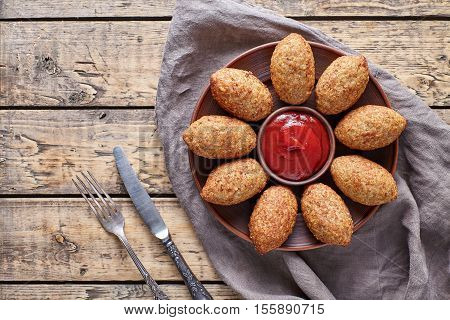 Kibbeh traditional middle eastern arabic lamb meat and bulgur kofta meatball croquettes food on vintage wooden table background