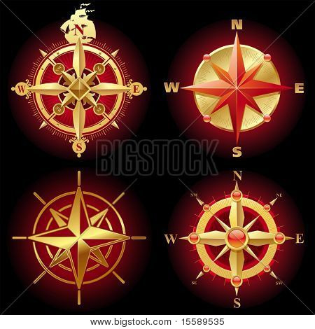 Four different golden compass rose