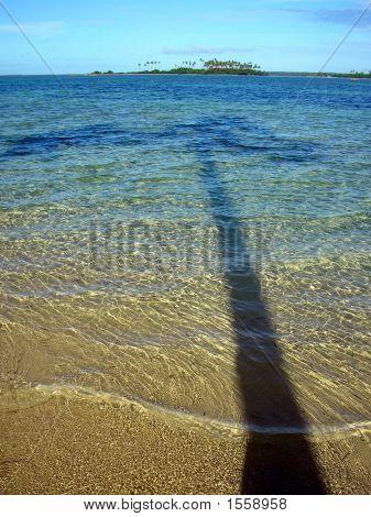 Shadow Of Coconut Tree Reaches Into Lagoon, Tonga
