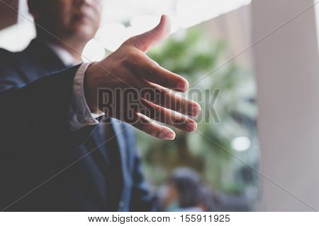 businessman handshaking in office - teamwork cooperation agreement acquisition concept
