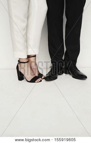 Fashion couple footwear low section studio shot