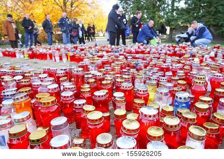 Large Group Of Candles On Cemetery