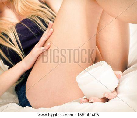 Self Caring Close Up Applying Creme On Leg