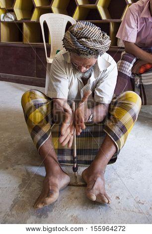 Socotra Yemen May 13th 2014: Yemeni man making fire