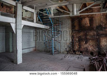 Modern spiral staircase in an abandoned Voronezh Distillery