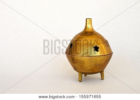 Gold Incense Burner on a White Background
