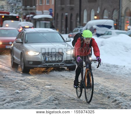 STOCKHOLM SWEDEN - NOV 10 2016: Snow chaos in the traffic in central Stockholm. Cars and bicycles. November 10 2016 in Stockholm Sweden