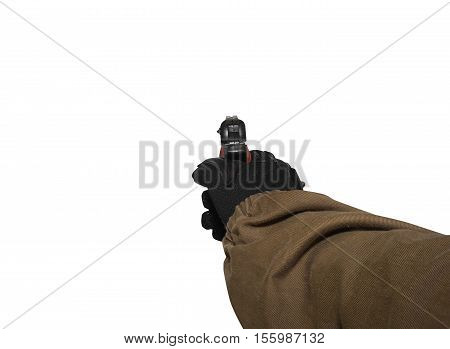 Isolated first person view soldier hand in black battle gloves & tactical jacket holding a ready to use gun.