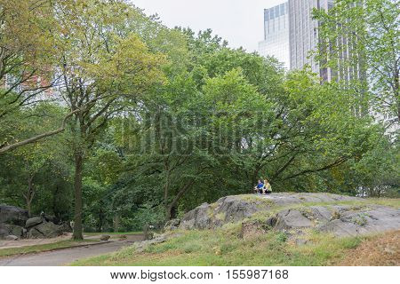 NEW YORK CITY - OCT. 8 2016: A couple of people enjoying a quite moment on the famous Umpire Rock in Central Park New York City