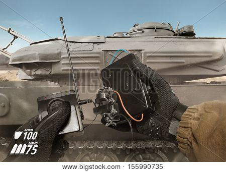 First person view soldier hand in black battle gloves & tactical jacket holding explosive & hand remote ready to place on desert armored tank with health & armor indicator.