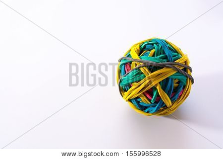 Ball from stationery rubber bands. Yellow green red blue and gray rubber band