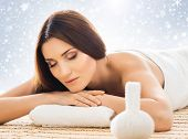 Young, healthy and beautiful girl relaxing in winter spa salon. Massage therapy, healing medicine an poster