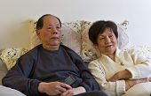 image of elderly couple  - Senior couple watching their favorite television show - JPG