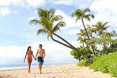 Hawaii beach couple walking on hawaiian beach, Kaanapali beach, Maui, Hawaii, USA. Travel vacation A poster