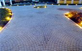stock photo of paving stone  - paved court yard with stone blocks and illumination