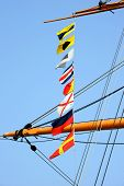 foto of yardarm  - naval signal flags on the mast of a sailing ship - JPG