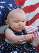Picture of patriotic baby with flag.