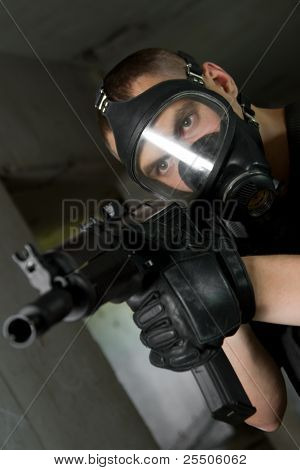 Soldier In Gas Mask Targeting With Ak-47 Rifle