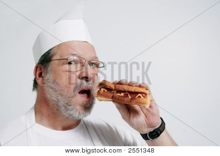 Cook Tasting His Hot Dog
