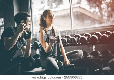poster of Fit Beautiful Young Woman Caucasian Attractive Fitness Woman Exercise With Dumbbell By Trainer In Gy