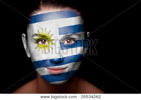 Portrait of a woman with the flag of the Uruguay
