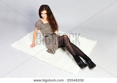 Brunette Girl  Isolated On Gray Background.