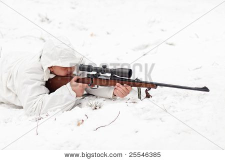 Sniper In White Camouflage Aiming On Snow.