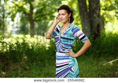 Brunette Caucasian Girl Calling By Mobile Phone.