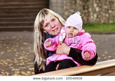 Young Mother With Baby On A Bench.