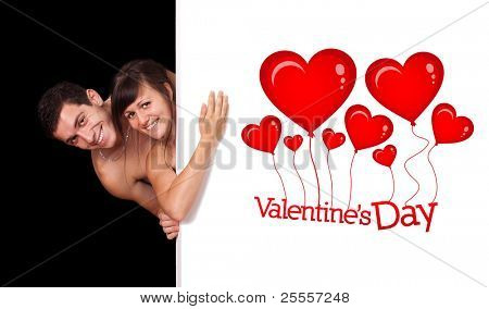 A cute couple behind a white wall, valentine's day theme