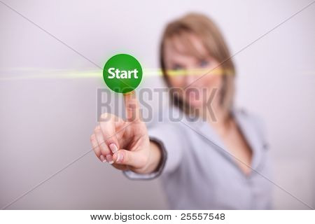 Woman pressing start button with one hand