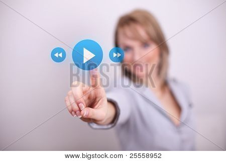 Woman pressing play and media button with one hand