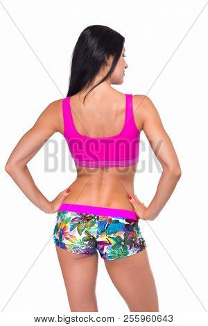 poster of Portrait of slim fitness cheerful girl with perfect fit body thumb up in studio over white backgroun
